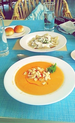 Tomato soup and the dish of Russian dumplings.